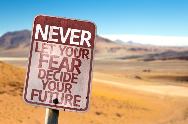 Never Let Your Fear Decide your Future sign with a desert backgr