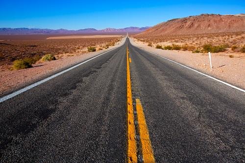 Never ending road to Death Valley California sunny desert