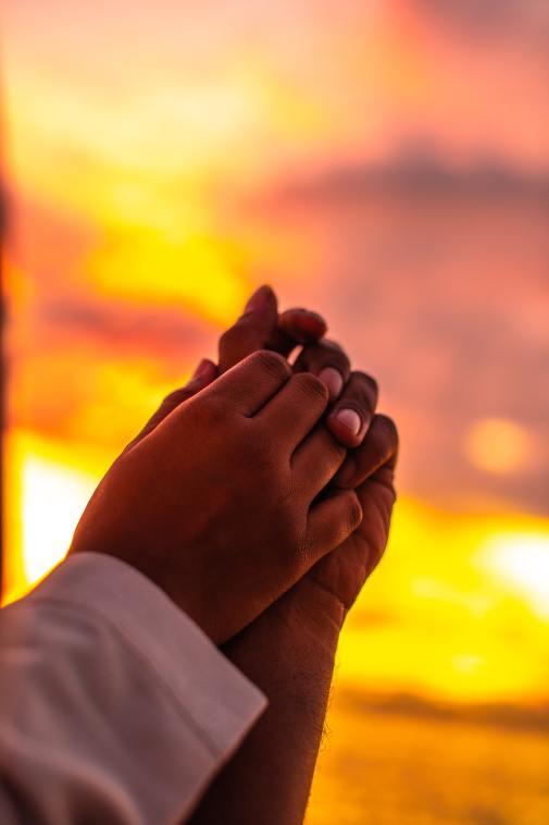 Hands praying together