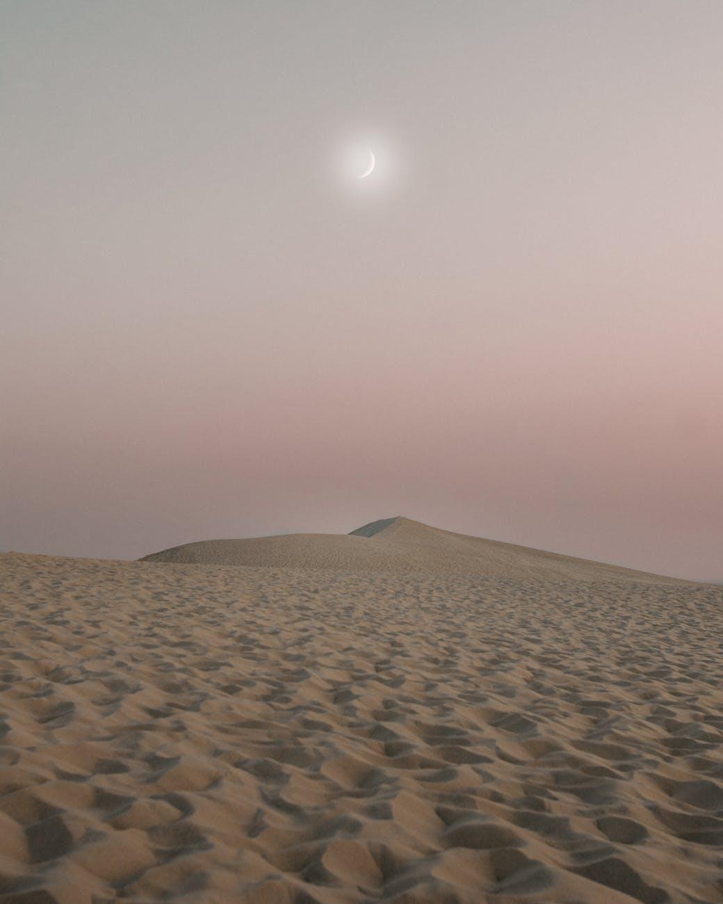 quarter moon and desert